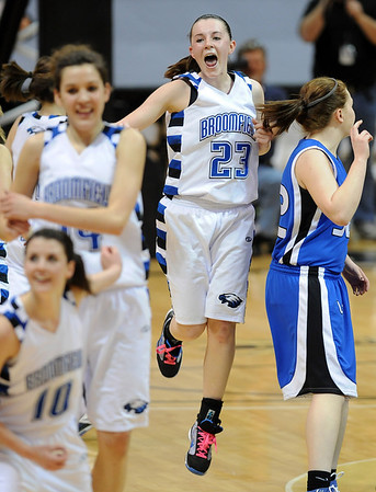 Sarah Hix (23), of Broomfield, celebrates the 4A State Championship against Longmont.<br /> Cliff Grassmick / March 12, 2010