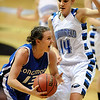 Jamie Katuna of Longmont drives past Katie Nehf of Broomfield.<br /> <br /> Cliff Grassmick / March 12, 2010