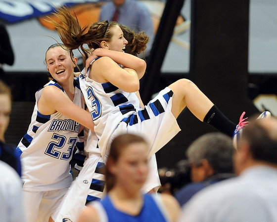 Sarah Hix, left, celebrates Broomfield's fourth  4A State Championship with teammates as the Eagles beat Longmont on Friday.<br /> <br /> Cliff Grassmick / March 12, 2010
