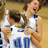 Brittany Zec of Broomfield jumps in the arms of Taylor Schreter after the Eagles won their fourth 4A State Championship.<br /> <br /> Cliff Grassmick / March 12, 2010