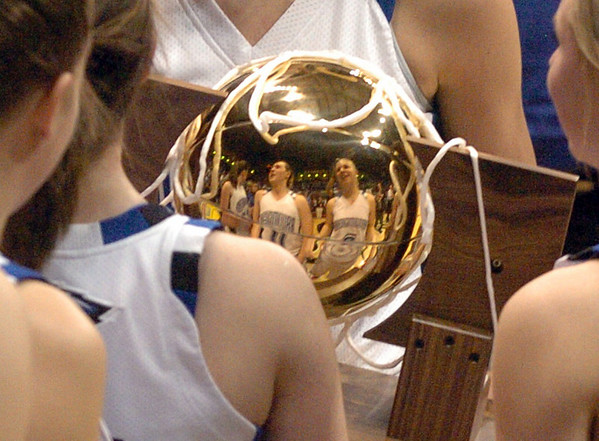 Broomfield players are reflected in the 4A State Championship trophy. The eagles won the title by beating Longmont.<br /> Cliff Grassmick / March 13, 2010