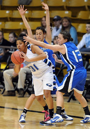 Tyana Medema of Broomfield gets pressured by  Jordan Aarguello, left, and Jamie Katuna, both of Longmont.<br /> <br /> Cliff Grassmick / March 12, 2010