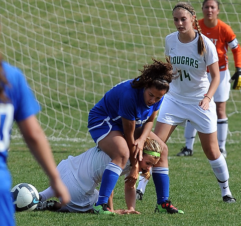Carly Kempf of Niwot gets caught between the legs of Hayli LaBadie of Broomfield.<br /> <br /> Cliff Grassmick / April 15, 2010
