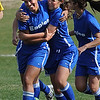 Hayli LaBadie, left, of Broomfield, is hugged by Kayla Baker, after Hayli's goal in the first half.<br /> <br /> Cliff Grassmick / April 15, 2010