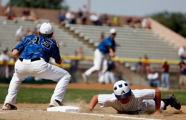 "Broomfield Eagle's Albert Garcia, #15, attempts to tag out Air Acadmey's Curtis Butler, #15,at first base during the championship game on Saturday, May, 26, 2012, Denver. <br /> Photo by Derek Broussard<br /> For more photos visit  <a href=""http://www.dailycamera.com"">http://www.dailycamera.com</a>"