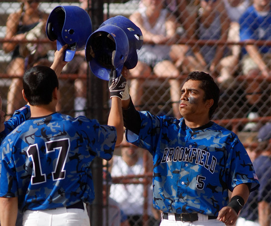 "Broomfield Eagle's Ben Martinez, #5,taps hit helmet with teammate Dylan Gable, #17, after he hit a homerun during the championship game on Saturday, May, 26, 2012, Denver. <br /> Photo by Derek Broussard<br /> For more photos visit  <a href=""http://www.dailycamera.com"">http://www.dailycamera.com</a>"