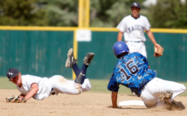 "Broomfield Eagle's Hayden Estes, #16, slides into second base before Air Acadmey's Curtis Butler, #15, can tag him out during the championship game on Saturday, May, 26, 2012, Denver. <br /> Photo by Derek Broussard<br /> For more photos visit  <a href=""http://www.dailycamera.com"">http://www.dailycamera.com</a>"