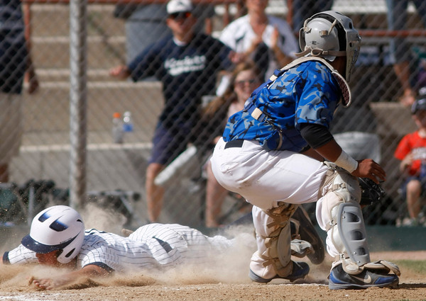 "Air Acadmey's Luke Yeager,Air Academy Kadets, slides safe into home base before Broomfield Ben Martinez can tag him out during the  championship game on Saturday, May, 26, 2012, Denver. <br /> Photo by Derek Broussard<br /> For more photos visit  <a href=""http://www.dailycamera.com"">http://www.dailycamera.com</a>"