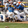 "The Broomfield Eagles dog pile after winning the state championship on Saturday, May, 26, 2012, Denver.<br /> Photo by Derek Broussard<br /> For more photos visit  <a href=""http://www.dailycamera.com"">http://www.dailycamera.com</a>"