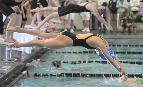 Broomfield's Abi Young goes off the blocks during the 200 yard medley relay at the 4A state championship swim meet at Mountain View High School in Loveland on Saturday.<br /> February 12, 2011 <br /> staff photo/David R. Jennings