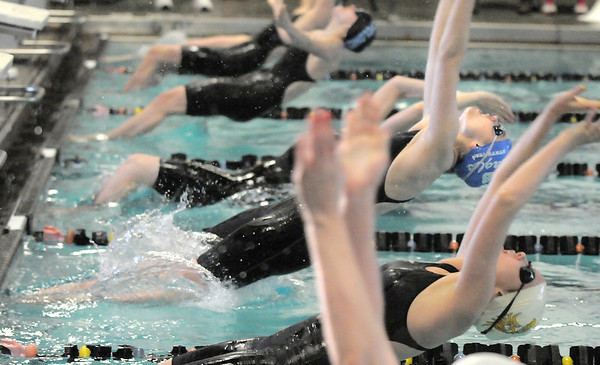 Broomfield's Katalena Laufasa-Duncan starts the 100 yard backstroke during the 4A state championship swim meet at Mountain View High School in Loveland on Saturday. <br /> February 12, 2011<br /> staff photo/David R. Jennings
