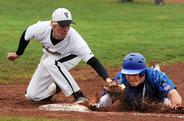 "Nick Leonard, right, of Broomfield, just gets back to first before the tag of Chris Sievers of Thompson Valley on Saturday.<br /> For a photo gallery of Broomfield baseball, go to  <a href=""http://www.dailycamera.com"">http://www.dailycamera.com</a>.<br /> Cliff Grassmick/ May 14, 2011"