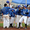 "Nick Hammett, right, celebrates a 2-run home run with his Broomfield teammates in the Thompson Valley game.<br /> For a photo gallery of Broomfield baseball, go to  <a href=""http://www.dailycamera.com"">http://www.dailycamera.com</a>.<br /> Cliff Grassmick/ May 14, 2011"