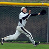 "Cole Mueller of Thompson Valley makes a running catch in the Broomfield game.<br /> For a photo gallery of Broomfield baseball, go to  <a href=""http://www.dailycamera.com"">http://www.dailycamera.com</a>.<br /> Cliff Grassmick/ May 14, 2011"