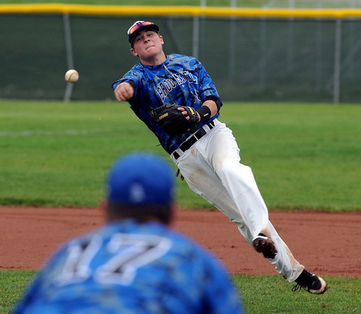 """Hayden Underberg of Broomfield makes a tough throw to first to get the out against Thompson Valley.<br /> For a photo gallery of Broomfield baseball, go to  <a href=""""http://www.dailycamera.com"""">http://www.dailycamera.com</a>.<br /> Cliff Grassmick/ May 14, 2011"""