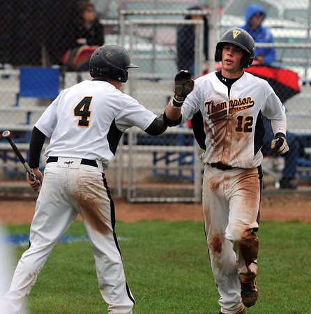 "Max Schoen (12)  of  Thompson Valley is greeted by Jeremy White after scoring a run against Broomfield.<br /> For a photo gallery of Broomfield baseball, go to  <a href=""http://www.dailycamera.com"">http://www.dailycamera.com</a>.<br /> Cliff Grassmick/ May 14, 2011"