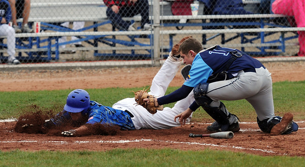 """Hayden Underberg, left, of Broomfield is tagged out at home by Josh Cooper of Widefield on Saturday.<br /> For a photo gallery of Broomfield baseball, go to  <a href=""""http://www.dailycamera.com"""">http://www.dailycamera.com</a>.<br /> Cliff Grassmick/ May 14, 2011"""