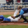 "Hayden Underberg, left, of Broomfield is tagged out at home by Josh Cooper of Widefield on Saturday.<br /> For a photo gallery of Broomfield baseball, go to  <a href=""http://www.dailycamera.com"">http://www.dailycamera.com</a>.<br /> Cliff Grassmick/ May 14, 2011"