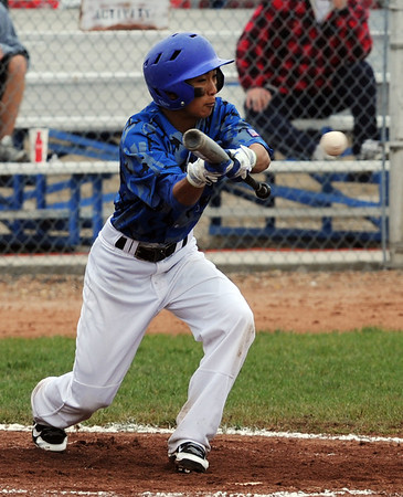 "Jeff Fukushima of Broomfield lays down a bunt in the Widefield game on Saturday.<br /> For a photo gallery of Broomfield baseball, go to  <a href=""http://www.dailycamera.com"">http://www.dailycamera.com</a>.<br /> Cliff Grassmick/ May 14, 2011"