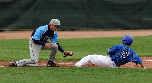 """Isaac Goscha of Widefield tags out Jeff Fukushima of Broomfield at third base on Saturday.<br /> For a photo gallery of Broomfield baseball, go to  <a href=""""http://www.dailycamera.com"""">http://www.dailycamera.com</a>.<br /> Cliff Grassmick/ May 14, 2011"""