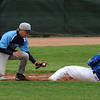 "Isaac Goscha of Widefield tags out Jeff Fukushima of Broomfield at third base on Saturday.<br /> For a photo gallery of Broomfield baseball, go to  <a href=""http://www.dailycamera.com"">http://www.dailycamera.com</a>.<br /> Cliff Grassmick/ May 14, 2011"