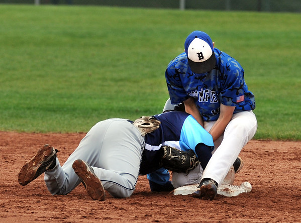 "Emilio Tujillo, left, of Widefield, and Nick Hammett of Broomfield battle around second base on Saturday.<br /> For a photo gallery of Broomfield baseball, go to  <a href=""http://www.dailycamera.com"">http://www.dailycamera.com</a>.<br /> Cliff Grassmick/ May 14, 2011"