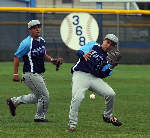 """Emilio Trujillo of Widefield looses this pop up in the game against Broomfield.<br /> For a photo gallery of Broomfield baseball, go to  <a href=""""http://www.dailycamera.com"""">http://www.dailycamera.com</a>.<br /> Cliff Grassmick/ May 14, 2011"""