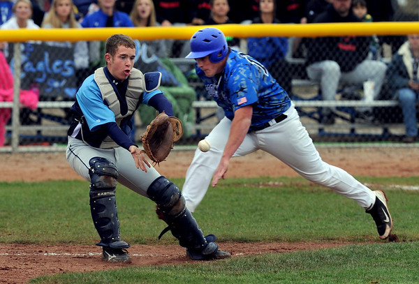 "Nick Leonard, right, of Broomfield, gets to home plate ahead of the throw. Josh Copper of Widefield waits for the throw.<br /> For a photo gallery of Broomfield baseball, go to  <a href=""http://www.dailycamera.com"">http://www.dailycamera.com</a>.<br /> Cliff Grassmick/ May 14, 2011"