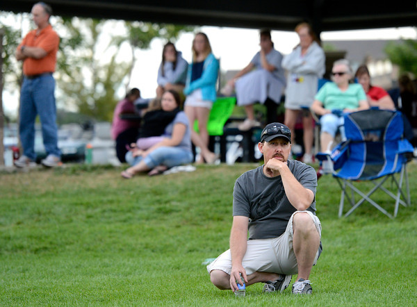 "Jesse Pietroiacovo, center, watches his son Brandon practice during the Broomfield Youth Football Association combine on Thursday, Aug. 2, at the Broomfield Commons Park red field in Broomfield. For more photos of the football camp go to  <a href=""http://www.dailycamera.com"">http://www.dailycamera.com</a><br /> Jeremy Papasso/ Camera"