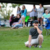 """Jesse Pietroiacovo, center, watches his son Brandon practice during the Broomfield Youth Football Association combine on Thursday, Aug. 2, at the Broomfield Commons Park red field in Broomfield. For more photos of the football camp go to  <a href=""""http://www.dailycamera.com"""">http://www.dailycamera.com</a><br /> Jeremy Papasso/ Camera"""