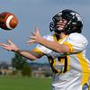 """Sean Bender makes a catch during a receivers drill at the Broomfield Youth Football Association combine on Thursday, Aug. 2, at the Broomfield Commons Park red field in Broomfield. For more photos of the football camp go to  <a href=""""http://www.dailycamera.com"""">http://www.dailycamera.com</a><br /> Jeremy Papasso/ Camera"""