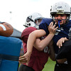 """Tanner Richards, center, tries to break through Ryan Russell, left, and Austin Almeida to get to the ball during the Broomfield Youth Football Association combine on Thursday, Aug. 2, at the Broomfield Commons Park red field in Broomfield. For more photos of the football camp go to  <a href=""""http://www.dailycamera.com"""">http://www.dailycamera.com</a><br /> Jeremy Papasso/ Camera"""