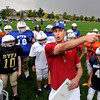 """Coach Shawn Gorman explains the drills to the kids during the Broomfield Youth Football Association combine on Thursday, Aug. 2, at the Broomfield Commons Park red field in Broomfield. For more photos of the football camp go to  <a href=""""http://www.dailycamera.com"""">http://www.dailycamera.com</a><br /> Jeremy Papasso/ Camera"""