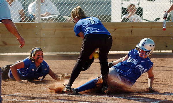"Eileen Simon, right, of Broomfield, is safe at home as Madeline Peterson, center, of Longmont tries to control the throw from Jade Eby, left.<br /> Longmont played its first game on the new softball field.<br /> For more photos of the game, go to  <a href=""http://www.dailycamera.com"">http://www.dailycamera.com</a>.<br /> Cliff Grassmick / August 26, 2010"