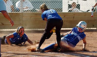 Eileen Simon, right, of Broomfield, is safe at home as Madeline Peterson, center, of Longmont tries to control the throw from Jade Eby, left. Longmont played its first game on the new softball field. For more photos of the game, go to www.dailycamera.com. Cliff Grassmick / August 26, 2010