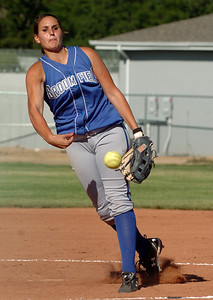 Chandler Moore of Broomfield pitches against Longmont. Longmont played its first game on the new softball field. For more photos of the game, go to www.dailycamera.com. Cliff Grassmick / August 26, 2010
