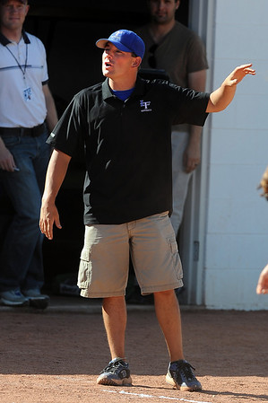 "Longmont softball coach  Bobby Matthews gives out instructions in the Broomfield game.<br /> Longmont played its first game on the new softball field.<br /> For more photos of the game, go to  <a href=""http://www.dailycamera.com"">http://www.dailycamera.com</a>.<br /> Cliff Grassmick / August 26, 2010"