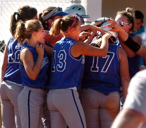 "Jessica Eatmon (17) of Broomfield, is mobbed by teammates after hitting an inside the park home run against Longmont.<br /> Longmont played its first game on the new softball field.<br /> For more photos of the game, go to  <a href=""http://www.dailycamera.com"">http://www.dailycamera.com</a>.<br /> Cliff Grassmick / August 26, 2010"