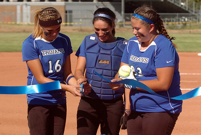 Sam Keller, left, Jade Eby, and Kellie Kirk, cut the official ribbon to open the new softball field at LHS. Longmont played its first game on the new softball field. For more photos of the game, go to www.dailycamera.com. Cliff Grassmick / August 26, 2010