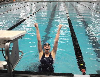 Lexie Roach, Broomfield, celebrates after finishing 9th in the 100 yard backstroke during Saturday's state 4A swim championships at Mtn. View Aquatic Center.  February 13, 2010 Staff photo/David R. Jennings