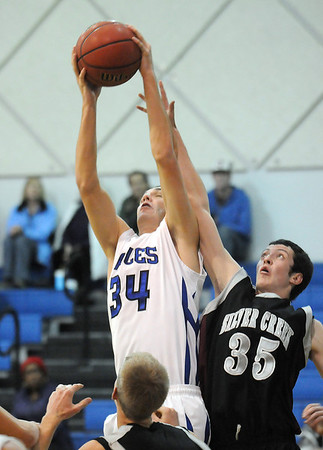 Nick Halliday, left, Broomfield rebounds the ball away from Brandon Bane, Silver Creek during Tuesday's game at Broomfield.<br /> <br /> <br /> December 15, 2009<br /> Staff photo/David R. Jennings