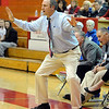 "Mike Croell, girls coach at Broomfield, works the game against Arvada West.<br /> For more photos of the game, go to  <a href=""http://www.dailycamera.com"">http://www.dailycamera.com</a>.<br /> December 10, 2011 / Cliff Grassmick"