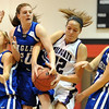 "Morgan Rynearson, left, Brianna Wilber, both of Broomfield, Corey Hendrickson of Arvada West, and Nicole Lehrer, of Broomfield, crash the boards to get a rebound on Saturday.<br /> For more photos of the game, go to  <a href=""http://www.dailycamera.com"">http://www.dailycamera.com</a>.<br /> December 10, 2011 / Cliff Grassmick"