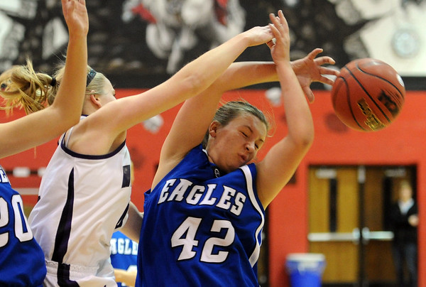 "Emily Chenowith, left, of Arvada West, knocks the ball away from Stacie Hull of Broomfield.<br /> For more photos of the game, go to  <a href=""http://www.dailycamera.com"">http://www.dailycamera.com</a>.<br /> December 10, 2011 / Cliff Grassmick"