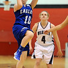 "Brianna Wilber of Broomfield  shoots past Emily Chenowith of Arvada West.<br /> For more photos of the game, go to  <a href=""http://www.dailycamera.com"">http://www.dailycamera.com</a>.<br /> December 10, 2011 / Cliff Grassmick"