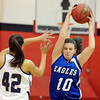 """Brianna Wilber of Broomfield works past Jalene Novotny of Arvada West.<br /> For more photos of the game, go to  <a href=""""http://www.dailycamera.com"""">http://www.dailycamera.com</a>.<br /> December 10, 2011 / Cliff Grassmick"""