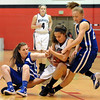 "Brianna Wilber, left,  of Broomfield, Corey Hendrickson of Arvada West, and Nicole Lehrer, of Broomfield, crash the boards to get a rebound on Saturday.<br /> For more photos of the game, go to  <a href=""http://www.dailycamera.com"">http://www.dailycamera.com</a>.<br /> December 10, 2011 / Cliff Grassmick"