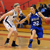 "Brittney Zek (22) of Broomfield, looks for room around Emily Chenowith of Arvada West on Saturday.<br /> For more photos of the game, go to  <a href=""http://www.dailycamera.com"">http://www.dailycamera.com</a>.<br /> December 10, 2011 / Cliff Grassmick"