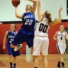"Meagan Prins of Broomfield, puts up a shot over Carrie Christopher  of Arvada West.<br /> For more photos of the game, go to  <a href=""http://www.dailycamera.com"">http://www.dailycamera.com</a>.<br /> December 10, 2011 / Cliff Grassmick"