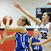 """Meagan Prins of Broomfield, puts up a shot under  Corey Hendrickson of Arvada West.<br /> For more photos of the game, go to  <a href=""""http://www.dailycamera.com"""">http://www.dailycamera.com</a>.<br /> December 10, 2011 / Cliff Grassmick"""